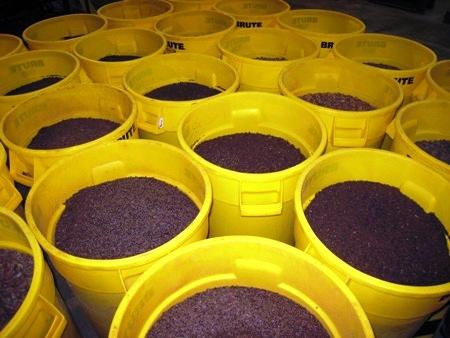 Barrels of nib bits are eventually granulated into rich chocolate liquor.