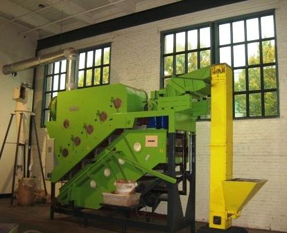 This machine cracks each cocoa seed into antioxidant-rich nib bits.
